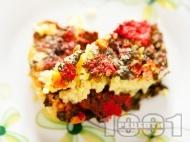 Вкусен бланширан лапад с ориз, моркови, лук и домати печен в тава на фурна